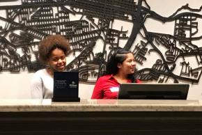 Students take a turn at the front desk which is the hub of customer service.