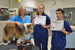 Animal Science outstanding students with their teacher and a dog