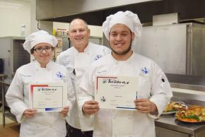 Two Culinary students with their teacher.