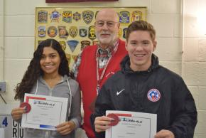 Two Criminal Justice students with their teacher, Mr. Gohn.
