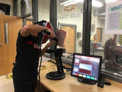 Student using the welding simulator
