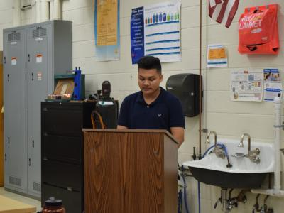 Student announcing his commitment to an employer to begin his training in the skilled trades profession.
