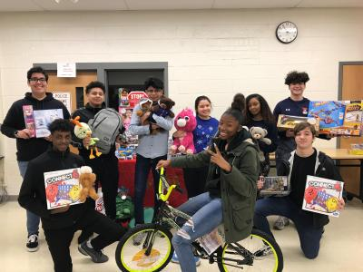 Students posed with toys