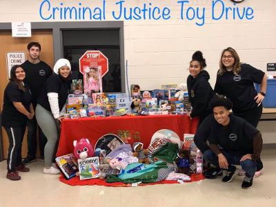 Criminal Justice students pose with donated toys.